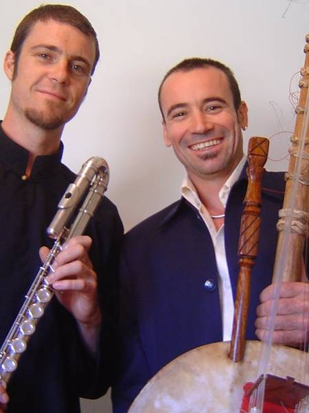 Two men holding flute and kora