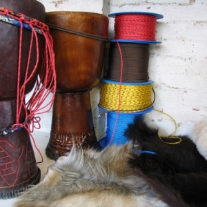 djembe shell, cord and goat skin on a bench