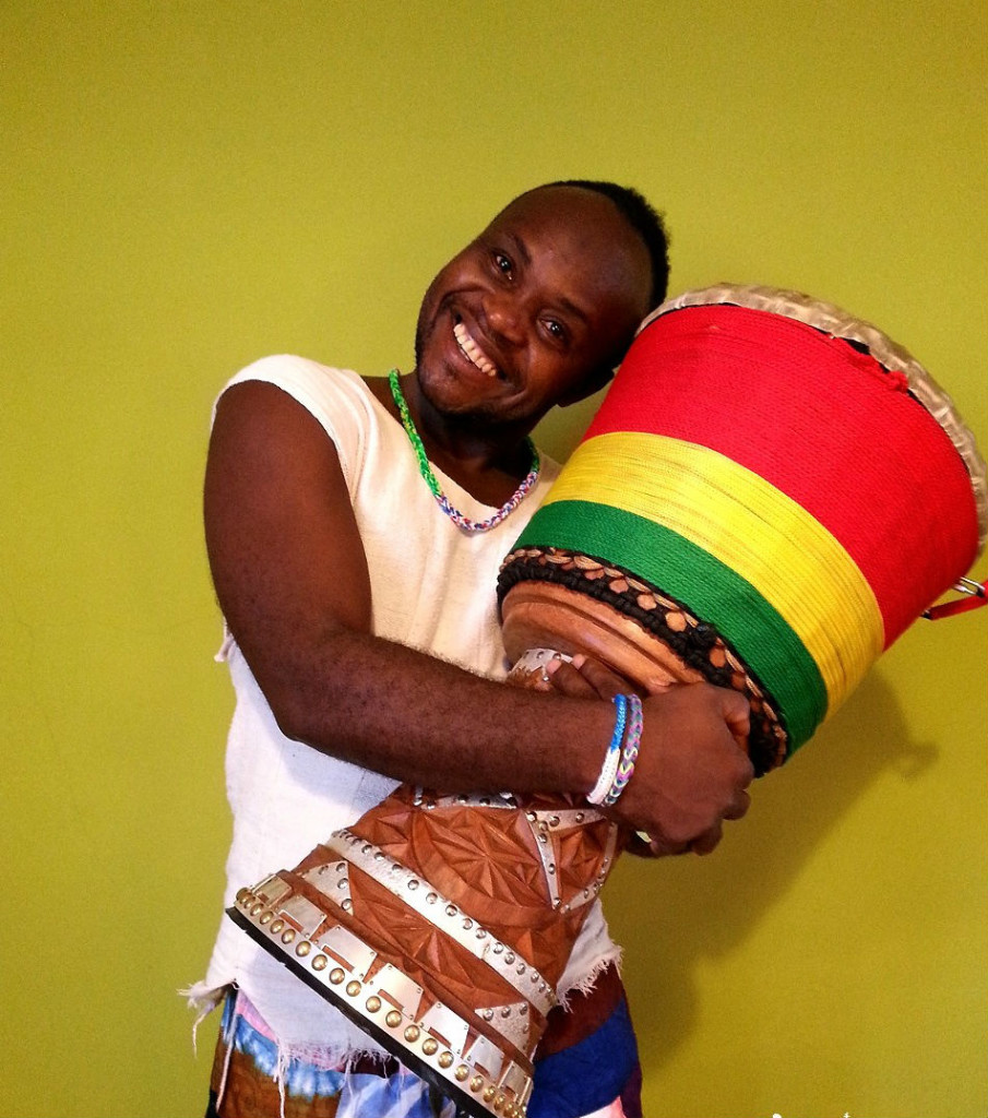 African man hugging his drum