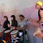 Djembe students and Simon Lewis playing at Buddha's Day