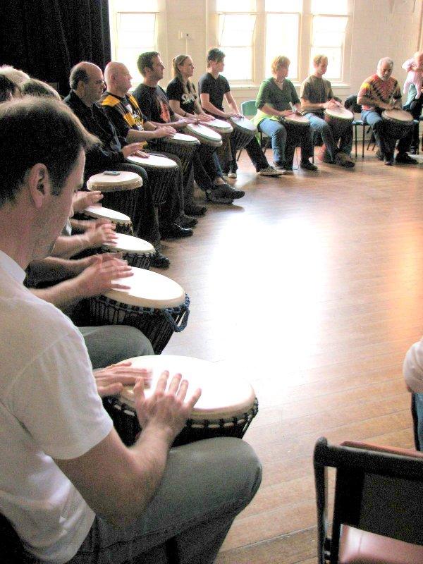 Drum circle (people playing djembes)