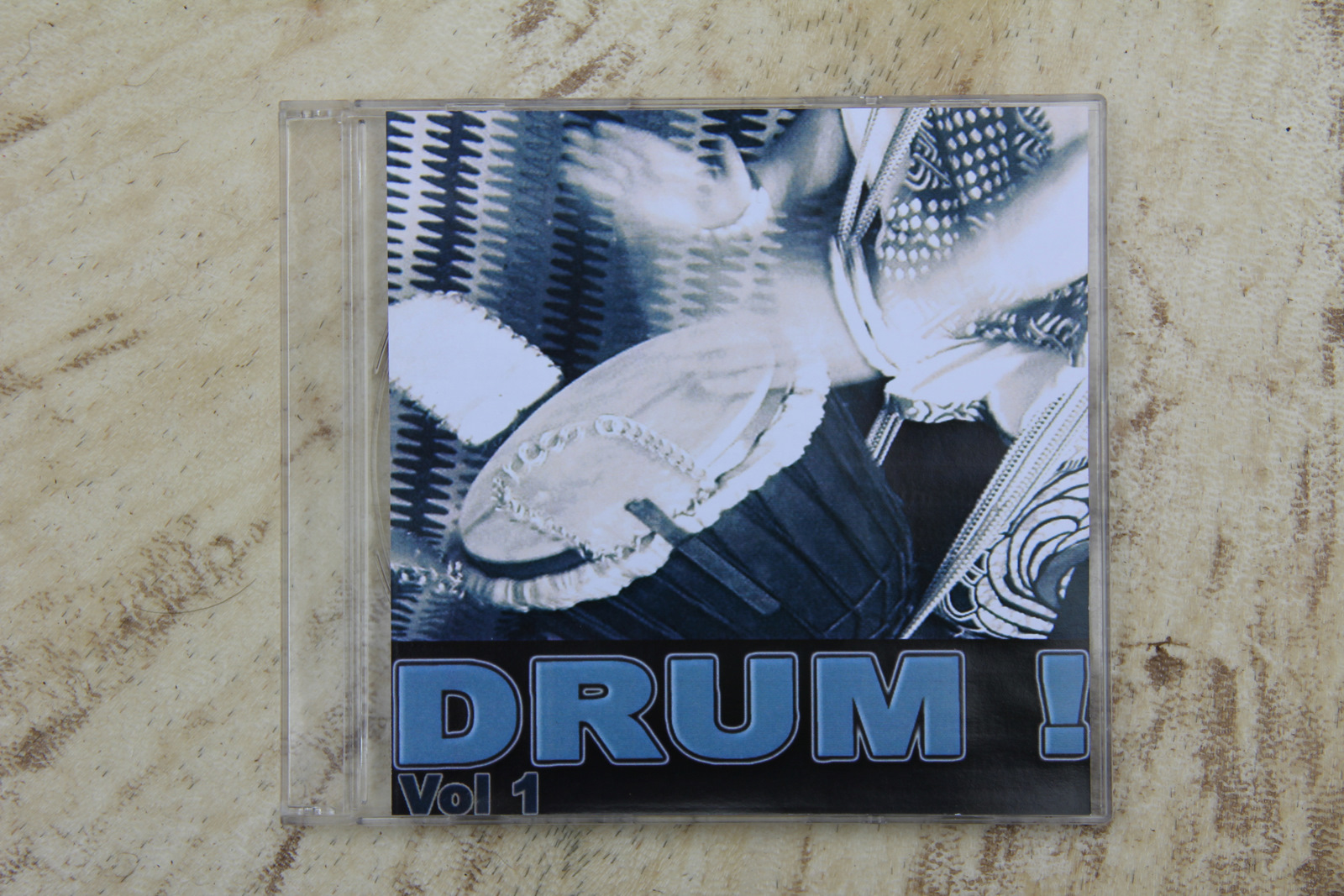 picture of CD cover with out of focus hands playing djembe