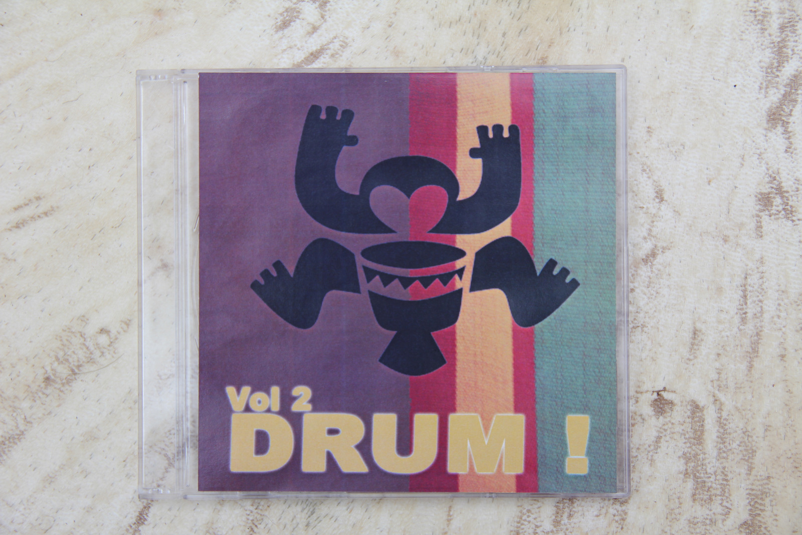 cover of CD with Melbourne Djembe logo playing djembe