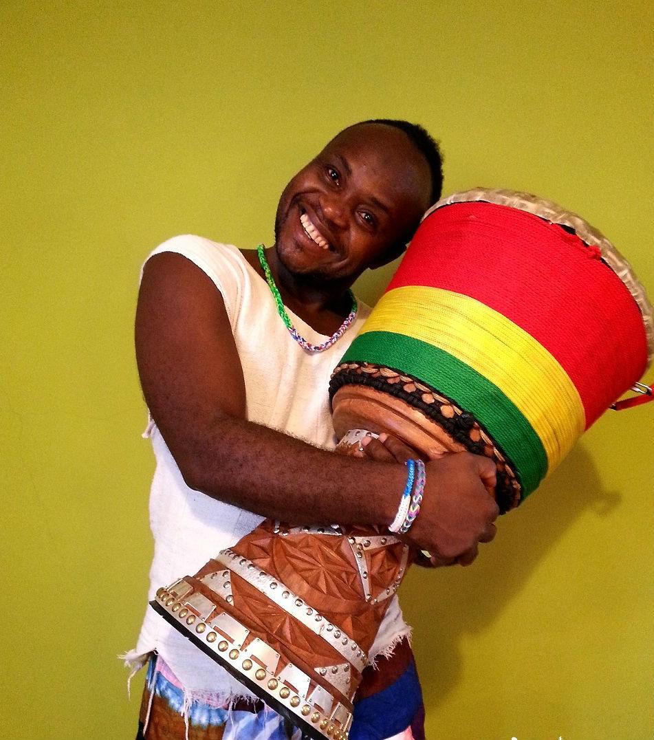 African man hugging his drum