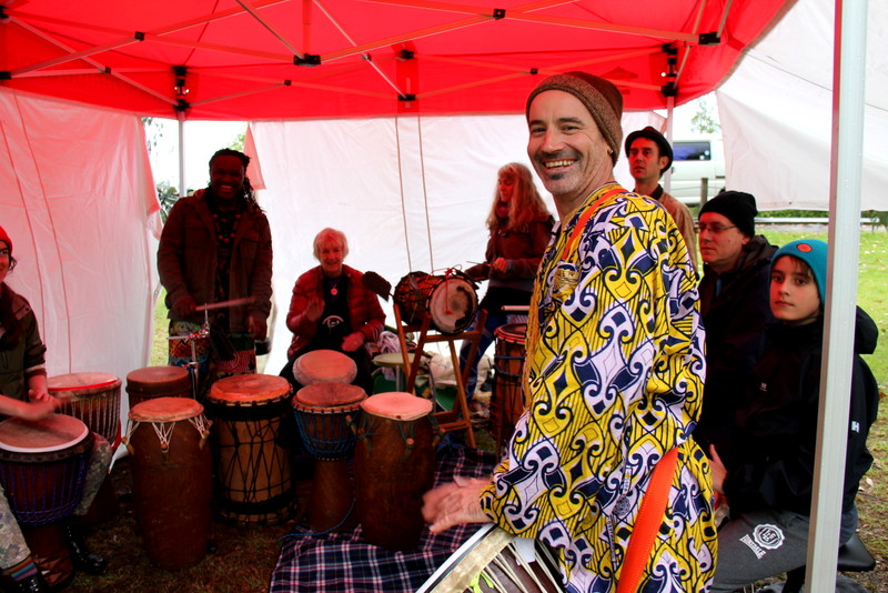 Simon Lewis playing djembe at Run with the Rhythm