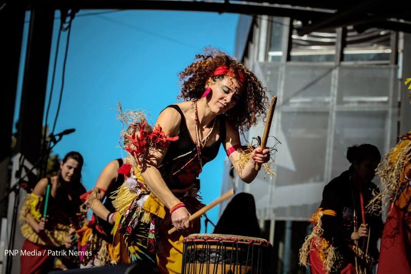 Dancer in costume playing dundun
